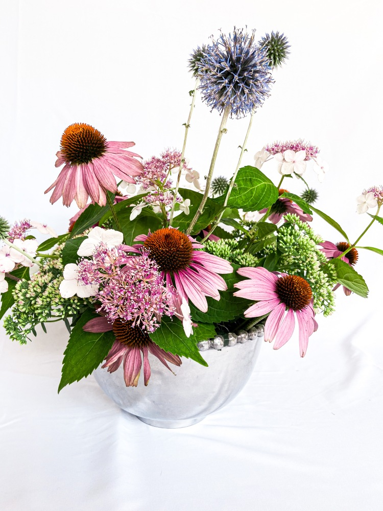 Whimsical Fairy Tale Centerpiece echinacea pink cone flowers, purple thistles